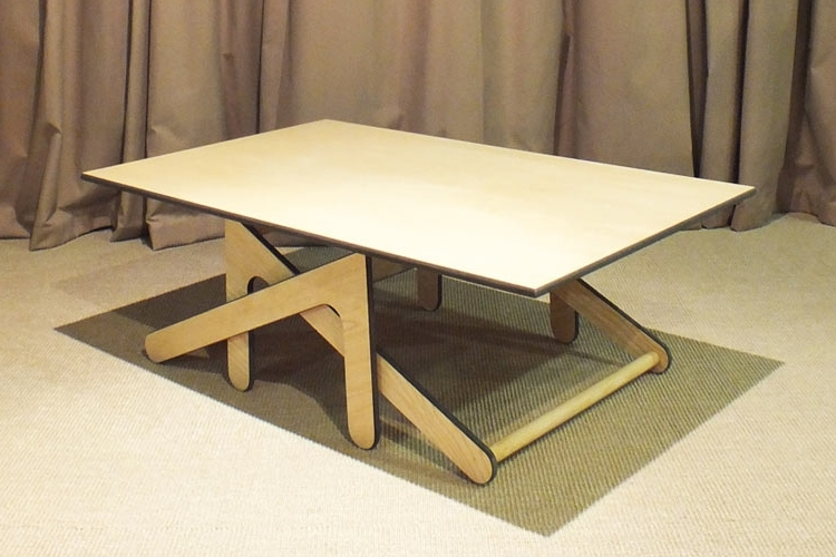 The M-Table uses legs that have two ends each – one shorter and one longer.  Each leg pivots inward to lower the table height and outward to raise it,  ... - M-Table Can Quickly Transform From Coffee Table To Dining Height